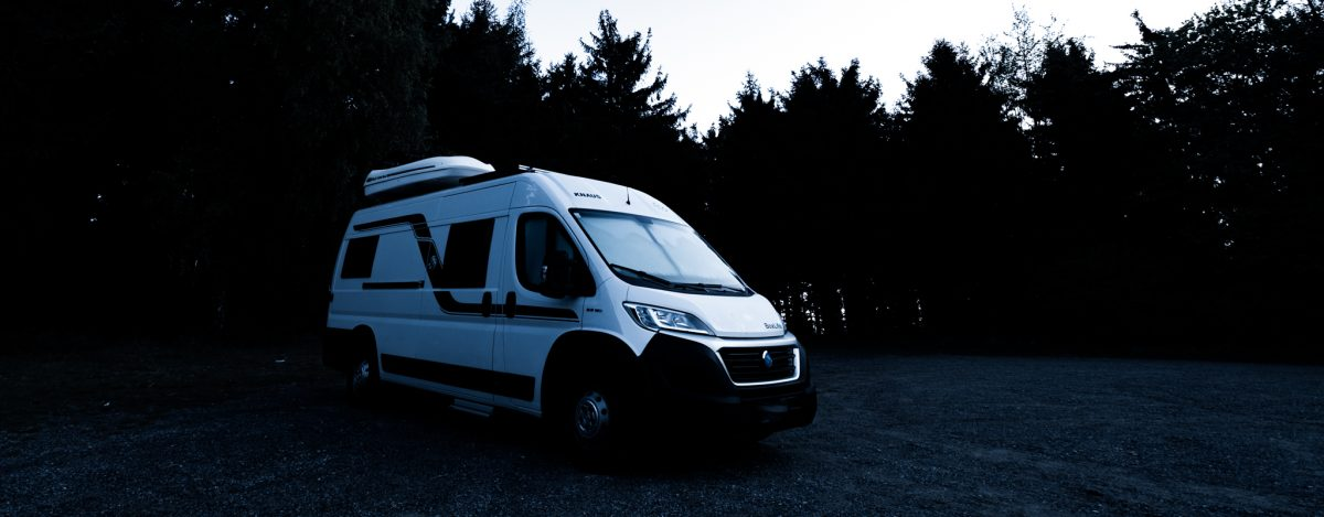 Camper van alone in the forest